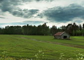 Menacing sky over barn in Southwest Finnish Lapland. — Stock Photo
