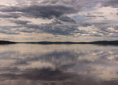 Manacing scaring skies over lake in Southwest Lapland, Finland, — Stock Photo