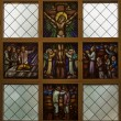 Stock Photo: Stained glass window picturing Jesus on Cross.