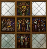Stained glass window picturing Jesus on the Cross. — Stock Photo