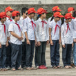 Stock Photo: Group of school children in uniform at parade ground Ho Chi Minh