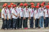 Group of school children in uniform at parade ground Ho Chi Minh — Stock Photo