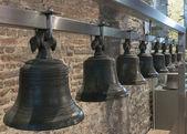 Collection of bells hangs in Ghent Belfry, Belgium. — Stock Photo