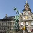 Brabo statue in front of historic Antwerp city hall. — Stock Photo