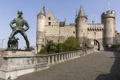 Lange Wapper statue and Antwerp Castle AKA Steen (stone). — Stok fotoğraf