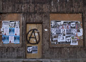 Anti Capitalism posters plastered over town by Anarchist. — Stock Photo