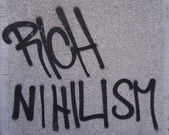 Graffiti slogan on Nihilism and against the Rich. — Stock Photo