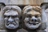 Fresco of angry and happy male's face set in stone. — Stock Photo