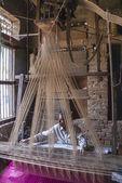 Man weaving with an acient Jacquart weaving machine. — Stock Photo