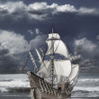 Stock Photo: Caravel floating on waves of sea
