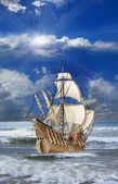 Caravel floating on the waves of sea — Stock Photo