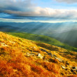Mountain landscape with sun — Stock Photo