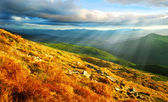 Mountain landscape with sun — Stock Photo