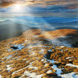 Stock Photo: Rays enlighten slopes in mountains Carpathians
