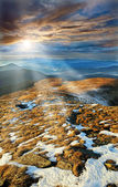Rays enlighten slopes in mountains Carpathians — Stock Photo