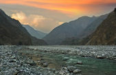 Evening sky and mountain river in the Himalayas — Stock Photo
