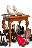 High heels in different colours on table — Stock Photo