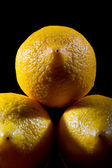 Three Lemons on plack background — Stock Photo