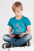 Boy with a digitizer — Stock Photo