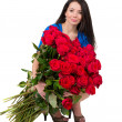 Brunette woman with a big bouquet of red roses — Stock Photo