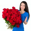 Pretty brunette holding a large bouquet of red roses — Stock Photo #24401503