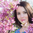 Woman near a flowering tree — Stock Photo