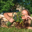 Girl with wild flowers — Stock Photo