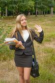 Schoolgirl with notebooks outdoors — Stock Photo