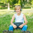 Boy with the tablet and headphones — Stock Photo