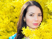 Woman in flowers Forsythia — Stock Photo