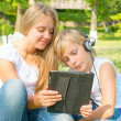 Boy and girl are in digital tablet — Stockfoto #34678095