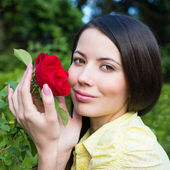 Portrait of a Woman with a red rose — Stock Photo