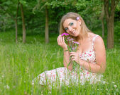 Woman with flowers in nature — Stock Photo