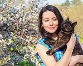 Young woman holding a cat — Stock Photo
