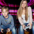 Boy and girl playing video games — Stock Photo #36642423