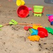 Children's plastic toys scattered on the beach — Stock Photo #40287787