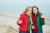 Portrait of mother with her daughter at the sea — Stock Photo