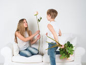 Boy gives a girl flowers — Stock Photo