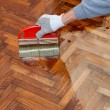 Home renovation, parquet varnish — Stock Photo #34171253