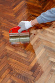Home renovation, parquet varnish — Stock Photo