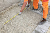 Construction site, brick paver measure — Stock Photo