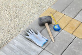 Construction site, brick paver and tools — 图库照片