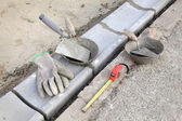 Construction site, curb stone and mason tools — Stock Photo
