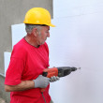 Construction site, styrofoam insulation drill — Stock Photo #47684865