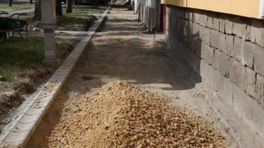 Pouring gravel from digger to pavement foundation, roadworks — 图库视频影像