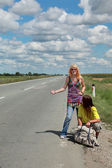 Hitch hiking couple — Stock Photo