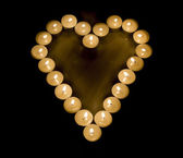 Heart made with candles — Stockfoto