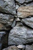 Wall of rough stone blocks — Stock Photo