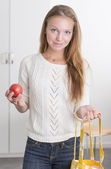 Young confident woman with reusable shopping bag — Stock Photo