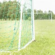 Empty soccer field with green grass — Stock Photo